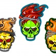 Human skulls with fire and wreaths — Stock Vector #75701787
