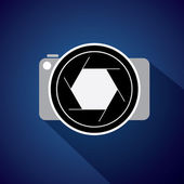 Digital camera with large lens & shutter - concept vector icon — Stock Vector