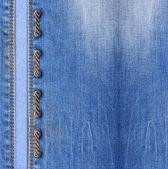 Blue jeans with lacing — Stock Photo