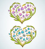 Blue and violet floral hearts — 图库矢量图片