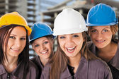 Smiling team female construction workers — Stock Photo