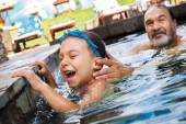 Laughter boy grandfather pool — Stock Photo