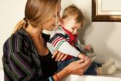 Smartfone fun mother baby technology — Stock Photo