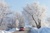 Car moving on beautiful winter road — Stock Photo