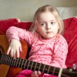 Little girl playing guitar — Stock Photo #67160247
