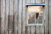 Wooden background. Wall of a peasant's house with a window — Stock Photo
