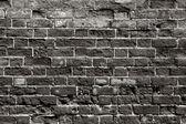 Old brick wall with dark bricks — Stock Photo