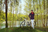 Bike riding - woman on bike in forest — Stock Photo
