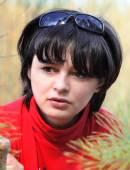Portrait of a beautiful pensive woman close up — Stock Photo