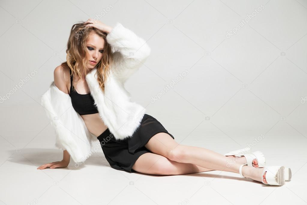 Model poses for fashion photography indoor