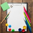 School supplies with blank on wooden background — Stock Photo #53905331