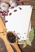 Paper for recipes and spices on wooden table — Stock Photo
