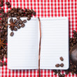 Blank paper, coffe bean and coffee cup on wood — Stockfoto #56469307