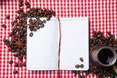 Blank paper, coffe bean and coffee cup on wood — Stockfoto