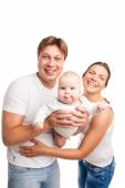 Happy family with the kid over white background — ストック写真