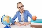 Smiling student girl in eyeglasses reading books — Stockfoto