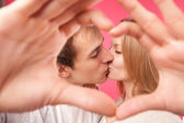 Couple making shape of heart by their hands — Stock Photo