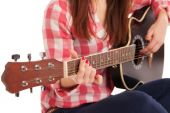 Womans hands playing acoustic guitar, close up — Stock Photo