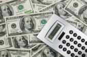 Calculator lies on a million dollars — Stock Photo
