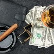 Cigar, ashtray, lighter, money, purse, glass on genuine leathe — Stock Photo #56926815