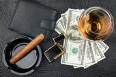 Cigar, ashtray, lighter, money, purse, glass   on genuine leathe — Stock Photo