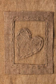 Conceptual image of the heart in the frame lying on sackcloth — Photo