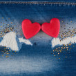 The concept of two lovers hearts lying on the jeans — Stock Photo #59101653