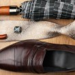 Classic mens shoes, tie, umbrella,cufflinks on the wooden floor — Stock Photo #60197637