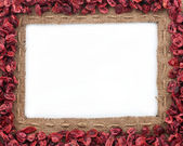 Frame made of burlap with dried cranberries — Stock Photo