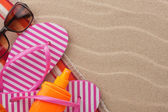 Accessories for the beach lying on the sand — Stock Photo