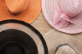 Four  hat lying on the undulating sand — Stock Photo