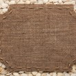 Frame made of burlap with stitches and place for your text lying — Stock Photo #65454927