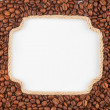 Figured frame made of rope with coffee beans lying on a white — Stock Photo #67359799