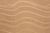 Costa del Sol inscription on the wavy sand — Stock Photo