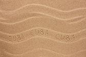 Cuba inscription on the wavy sand — Stock Photo
