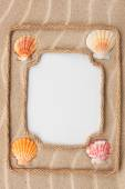 Two beautiful frame made of rope and sea shells with a white bac — Stock Photo