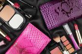 Beautiful pink and lilac bags among cosmetics — Stockfoto