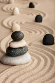 Pyramid  made of  stones standing on the sand — Stock Photo