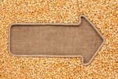Pointer made from rope with grain peas  lying on sackcloth — Stock Photo
