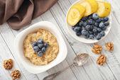 Porridge with bananas and blueberry — Stock Photo