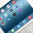 Social media icons on screen of iPad Air 2 — Stock Photo #64792961