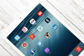 Social media icons on screen of iPad — Stock Photo