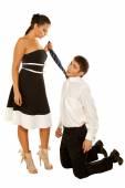 Girl holds the tie guy kneeling — Stock Photo