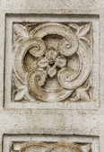 Church detail of stone art on bas relief — Stock Photo