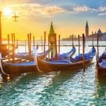 Venetian gondolas at sunrise — Stock Photo #55939069