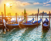 Venetian gondolas at sunrise — Stock Photo