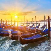 Venetian gondolas at sunrise — Stock Photo