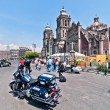 Постер, плакат: Police motorbike and people in Mexico City downtown