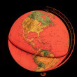 Terrestrial globe on black background — Stock Photo #69988081