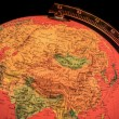 Terrestrial globe on black background — Stock Photo #69988843